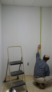 Measure the wall for the first panel length. Mark the panel width on the wall.